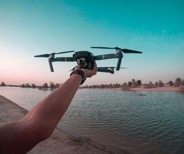 photo of a person holding a drone 1506991 1
