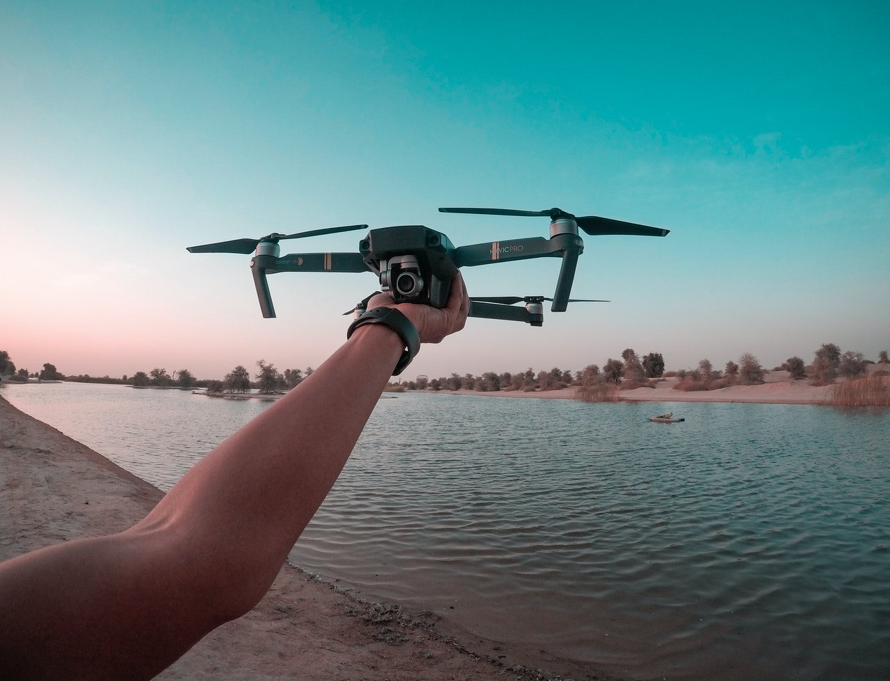 photo of a person holding a drone 1506991