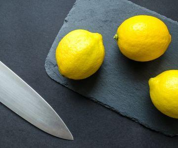 photo of three lemons on chopping board near knife 952369 1
